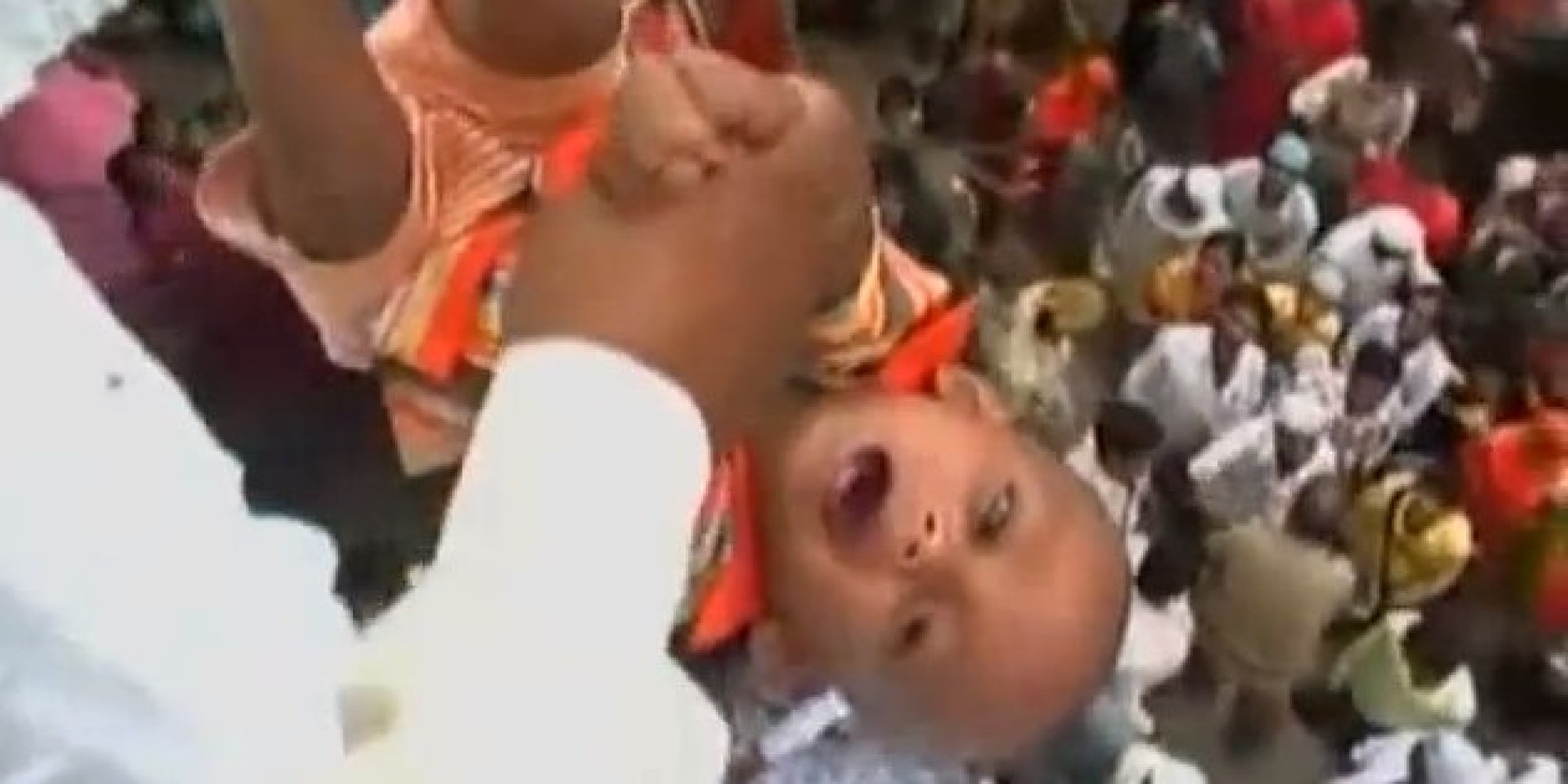 Villagers throw babies from temple roof